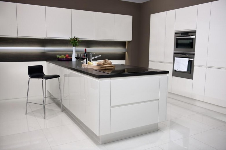 monochrome-magic-e28093-white-hi-gloss-units-with-striking-black-worktops-from-habitats-new-fitted-kitchens-range